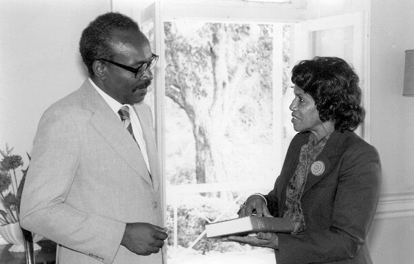 1983_November_Ruth_Pringle_making_a_Presentation_to_Gov_General_Sir_Paul_Scoon_a
